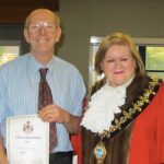 Philip Knighton being presented with his Good Citizenship certificate by Taunton Mayor Libby Lisgo