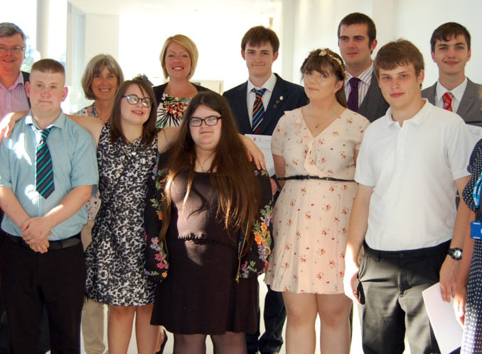 Eight of Musgrove's Project SEARCH interns are pictured with (far left to right): Laura Ellison (Tutor), Patrick Flaherty (Chief executive – Somerset County Council), Dawn Peters (Project SEARCH coordinator), Hannah Phillips (Job coach), and (far right): Hayley Peters (Executive director of patient care – Musgrove Park Hospital)