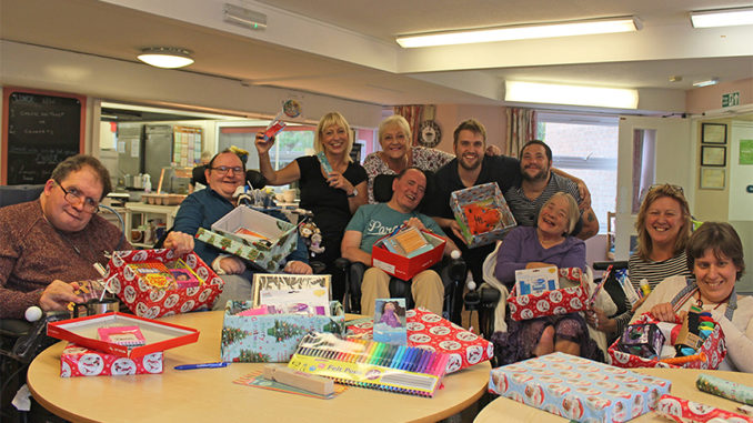 Clients and staff at the Halcon Centre starting on their shoeboxes. (L-R) Robert, David, Steph, Janet, Richard, Kevin, Ben, Maritza, Mandy and Magda.